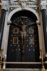 Jesus on the cross sculpture on street facade in Trogir, Croatia