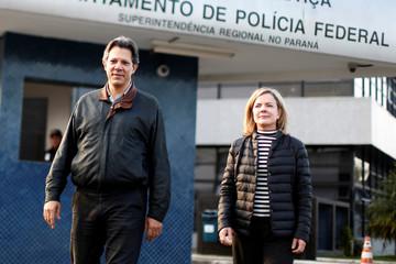 Former Sao Paulo mayor Haddad and Senator Hoffmann leave the Federal Police headquarters, where Brazilian former President Lula da Silva is imprisoned, in Curitiba