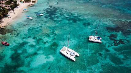 Yachts and boats in the bay. Beautiful bay with turquoise water. View from above