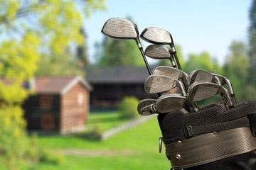 Different golf clubs on natural  background