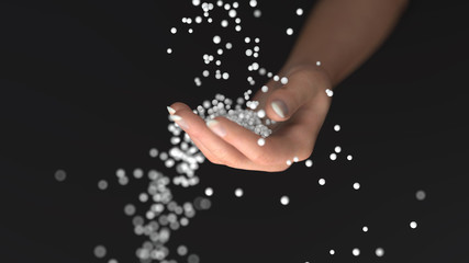 white granules fall into the hand