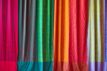 Mix colourful and pattern hanging vertical stripe textile fabrics. Mixed of red, green, yellow,...