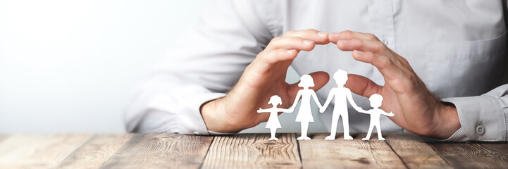 Protecting Hands Over Paper Family / Family Protection And Care Concept  Wall mural