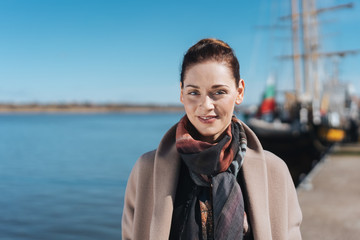 Attractive woman walking along a quay