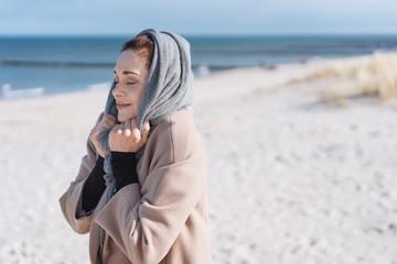 Contented young woman enjoying the winter sunshine