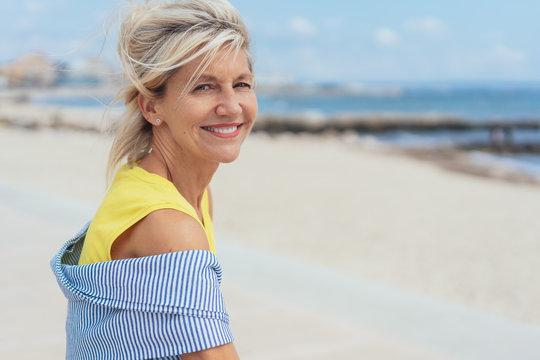 Trendy blond woman on a sandy beach