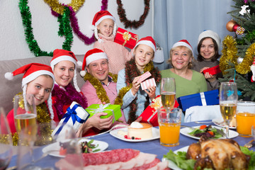 Family is posing with gifts in time celebration New Year