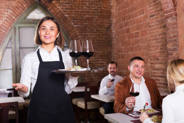 Female waiter in country restaurant