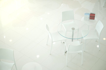 White Chair for the Customer testimonials in car showroom. Meeting room.