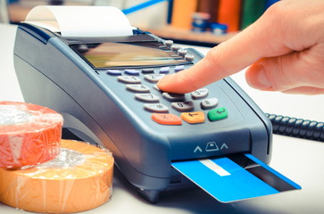 Paying with credit card in electrical shop, enter personal identification number