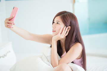 woman selfie on the bed