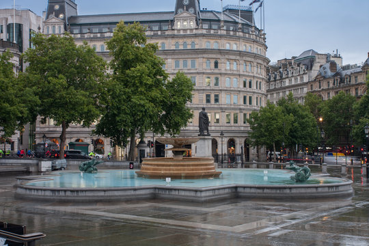 The fountain on Trafalgar square in rainy early morning time  in London, United Kingdom