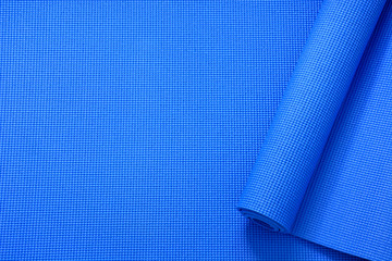close up roll blue color yoga mat texture background,top view, copy space, healthy lifestyle, sport and  exercise concept