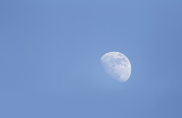 white moon on a blue sky during daytime