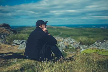 Senior man relaxing on the moor