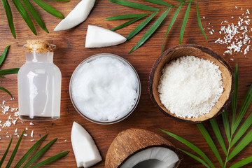 Set of organic coconut products for spa treatment, cosmetic or food ingredients. Oil, water and shavings top view. Flat lay.