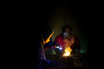 Industrial Worker at the factory welding closeup, welder Industrial automotive part in factory, selective focus.
