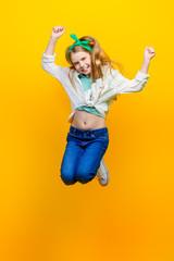 girl jumping at studio