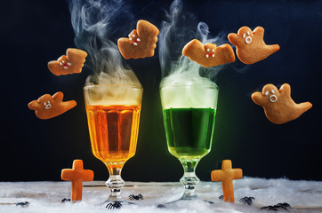 Halloween drinks with flying cookies on a black background
