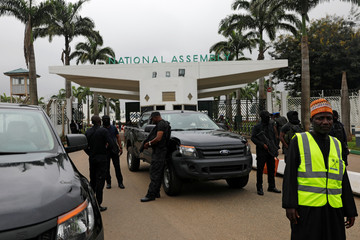 Members of security forces stand at the entrance of the National Assembly in Abuja
