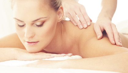 Healthy and Beautiful girl in Spa. Recreation, Energy, Health, Massage and Healing Concept.