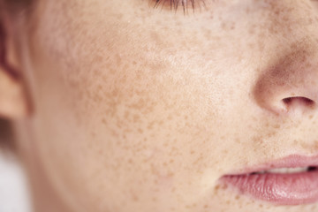 Close up of woman's face with freckles Wall mural