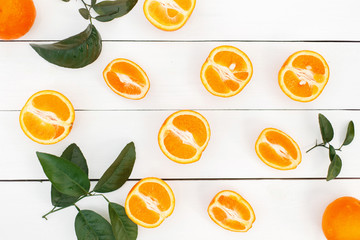 Fresh delicious orange with leaves on a white wooden table