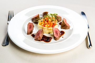 Roasted lamb fillet with potato and vegetable ragout