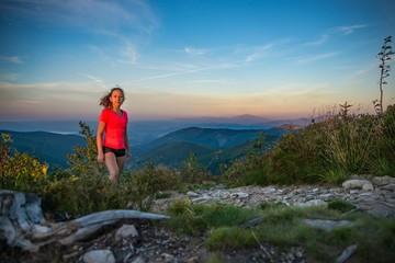 Young beautiful woman on mountain trail