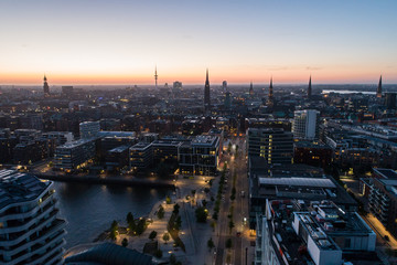 "Aerial view of the harbor district, the concert hall ""Elbphilharmonie"" and downtown Hamburg, Germany, at dusk. Panorama."