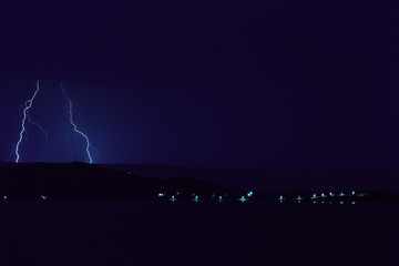 Nature lightning bolt at night thunder storm sea near