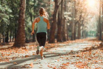 Keuken foto achterwand Jogging Woman Jogging Outdoors in The Fall
