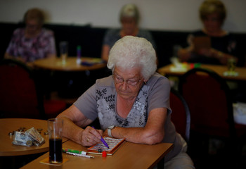 A woman plays Bingo inside the Kellingley Social Club in Knottingley
