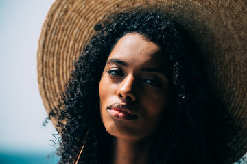 Portrait of a black woman with straw hat
