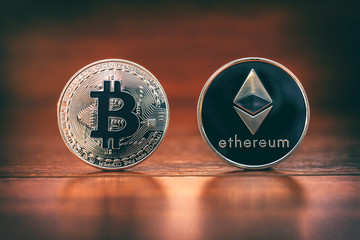 Cryptocurrency pair Bitcoin and Ethereum on wood