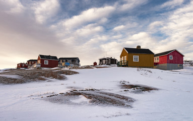 Colourful houses in the tiny inuit village of Oqaatsut in west Greenland