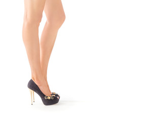 Closeup photo of sexy female legs in high heels shoes. isolated on white.