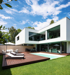 Exterior modern white villa with pool and garden
