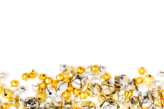 Gold and silver Jingle bells Christmas background. Flat lay,  top view