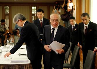 Tetsuo Yukioka, Managing Director of Tokyo Medical University and Keisuke Miyazawa, Vice-President of Tokyo Medical University, leave after a news conference in Tokyo
