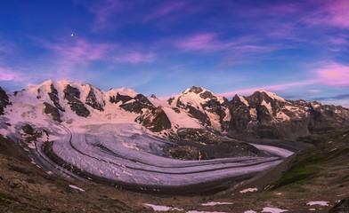 Panoramic view of Vedret Pers Glacier at sunrise. Diavolezza Refuge, Bernina Pass, Engadin, Graubünden, Switzerland, Europe.