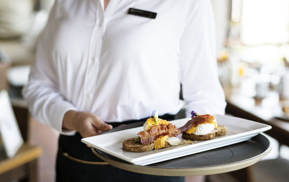 Waitress working in a hotel restaurant
