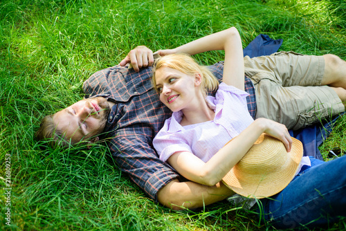 Couple in love relaxing outdoors  Guy and girl dreamy relaxed enjoy