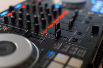 Black audio controller. DJ mixing console