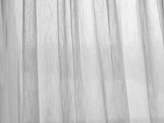 Closeup of a white net curtain in detail