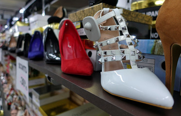 Made in China women shoes are seen in a shop run by Chinese people in Rome