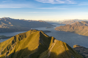 View of Lake Wanaka from Roys Peak lookout before sunset. Wanaka, Queenstown Lakes district, Otago region, South Island, New Zealand.