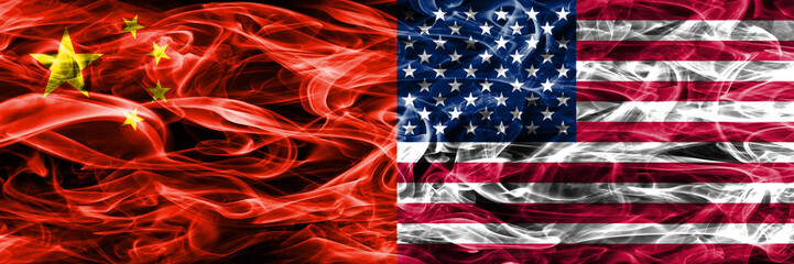 China vs United States smoke flags placed side by side. US American flag