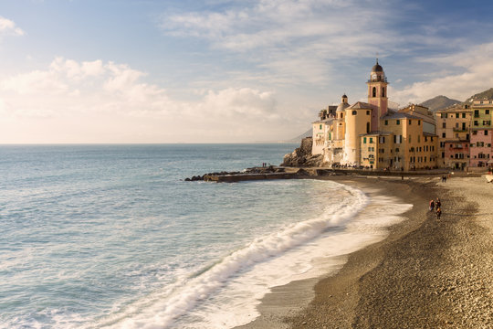Scenic view of Camogli beach against cloudy sky