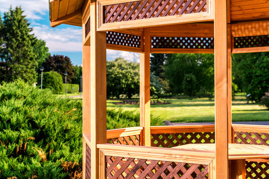 Outdoors wooden gazebo over summer landscape